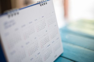 50281886 - blurred calendar page blue background.